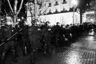 A line of police in riot gear