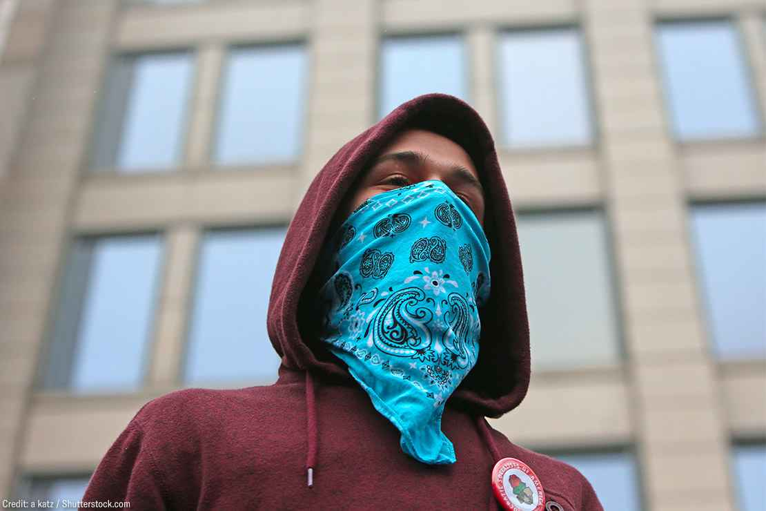 A demonstrator wearing a bandana on their face