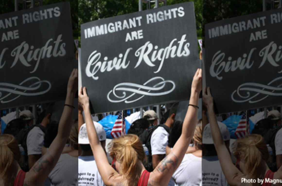 immigrant rights sign at rally