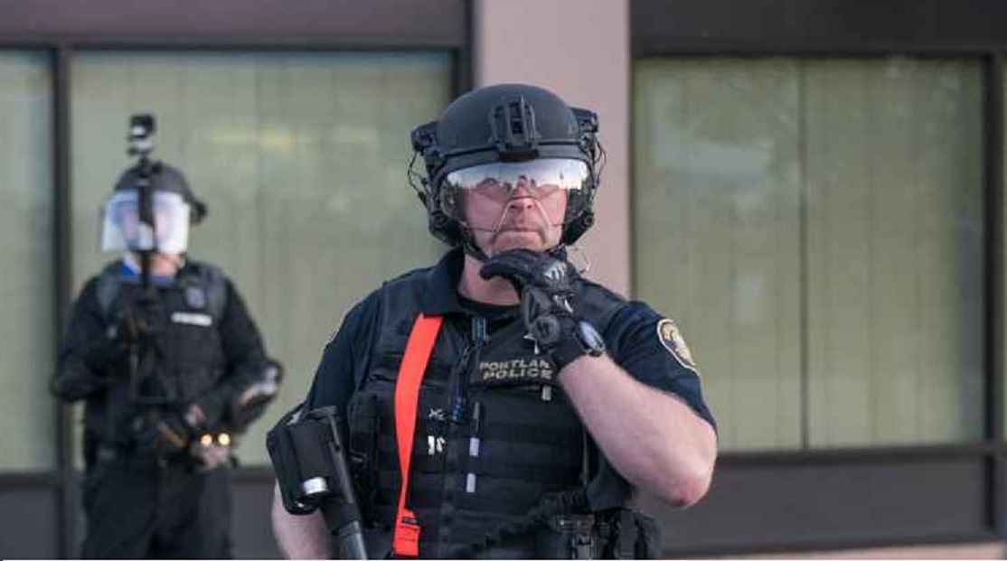 Photo of Portland police officer livestreaming protest