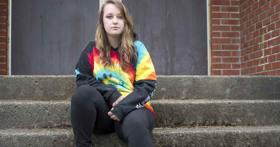 Liv Funk sits on the steps of North Bend High School